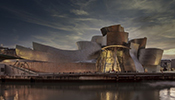 The Guggenheim Museum Bilbao was designed by architect Frank O. Gehry in the deconstructivist style.